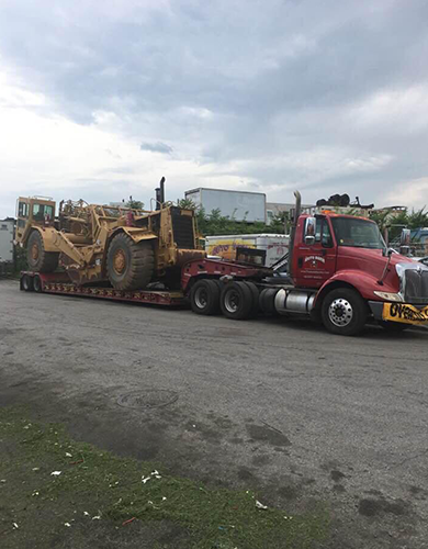 Truck Hauling a Large Construction Machine